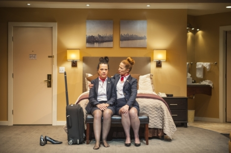 Flight attendant Sam (r, Rebecca Dines*) and Beth (l, Jamie Jones*) to join her for a night on the town in Aurora Theatre Company's Bay Area Premiere of Mud Blue Sky